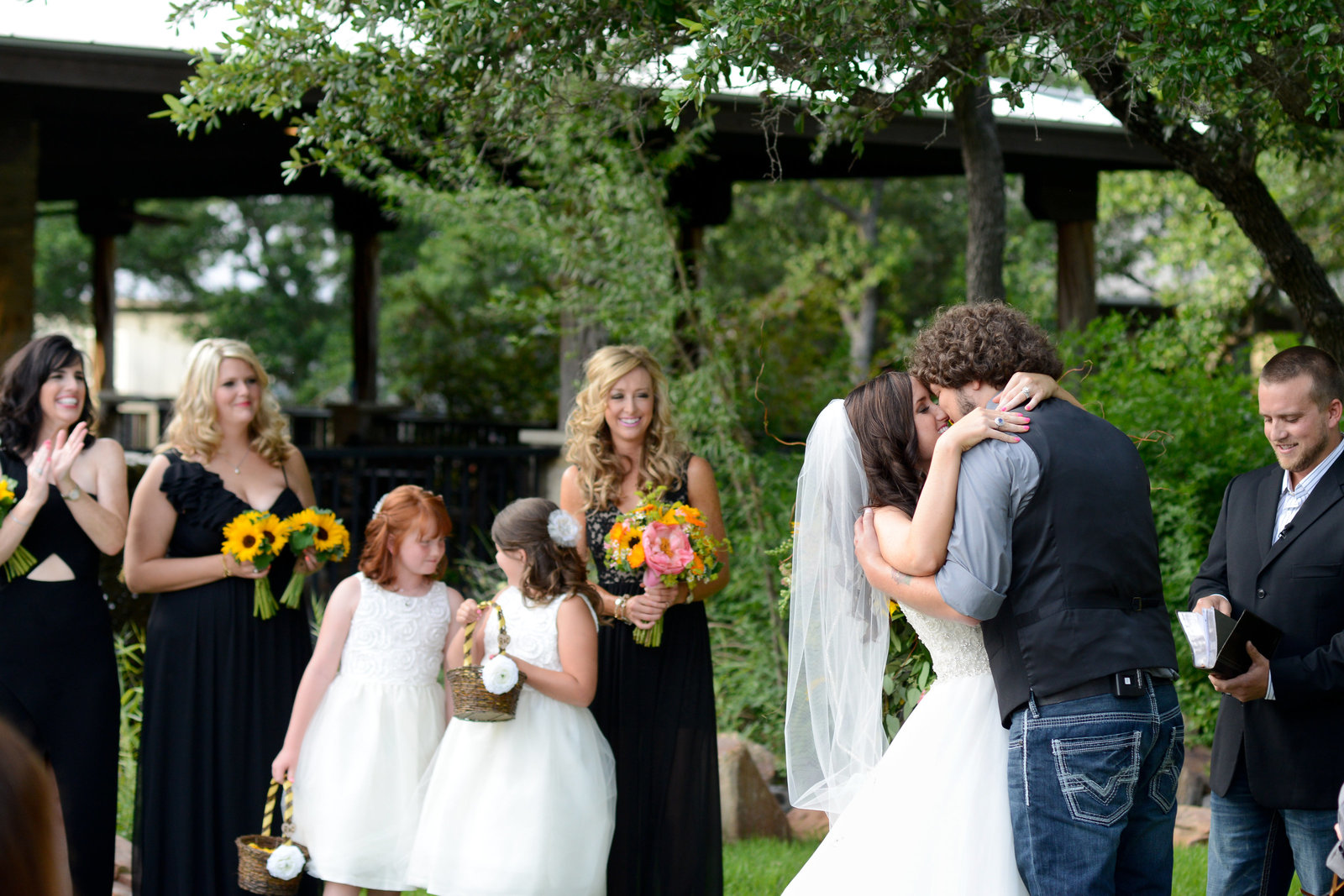 Husband and wife share first kiss on wedding day at Spicewood Vineyards