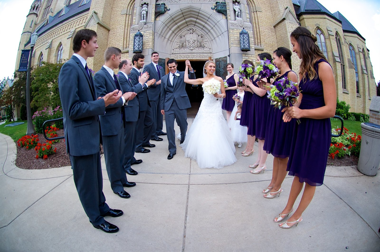 The Bride and Groom Exit the Basilica of the Sacred Heart at the famous God, Country, Notre Dame door, Notre Dame, IN
