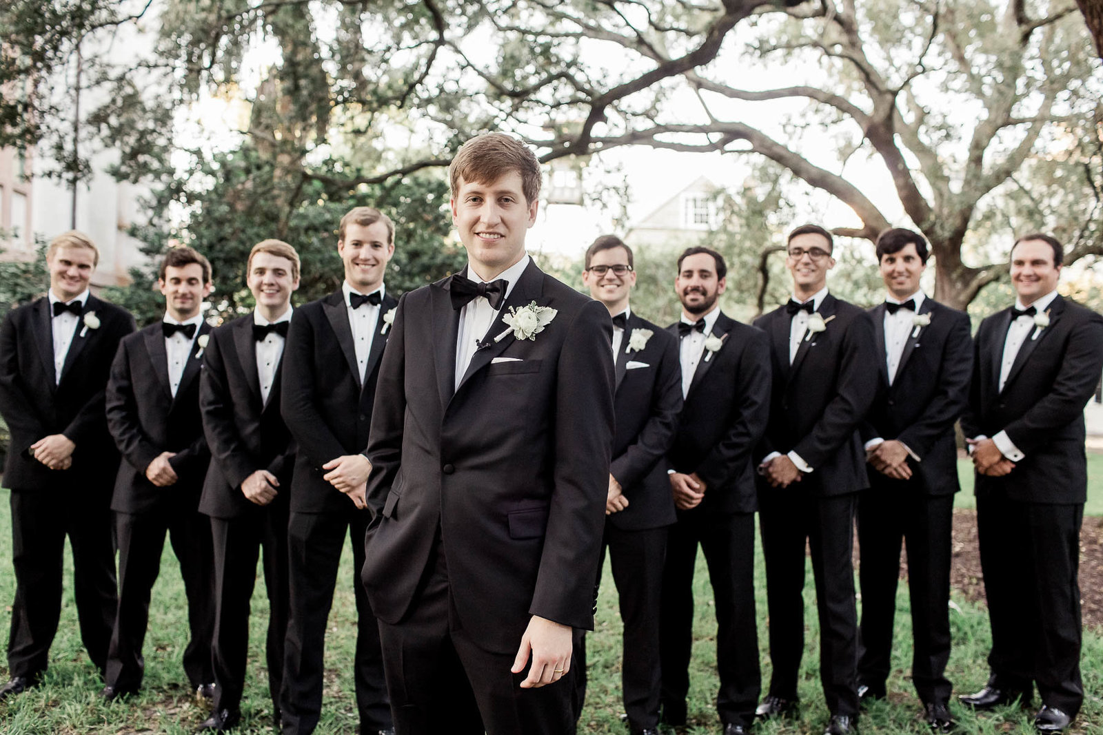 Groom and groomsmen under trees in Washington Square, Charleston, South Carolina