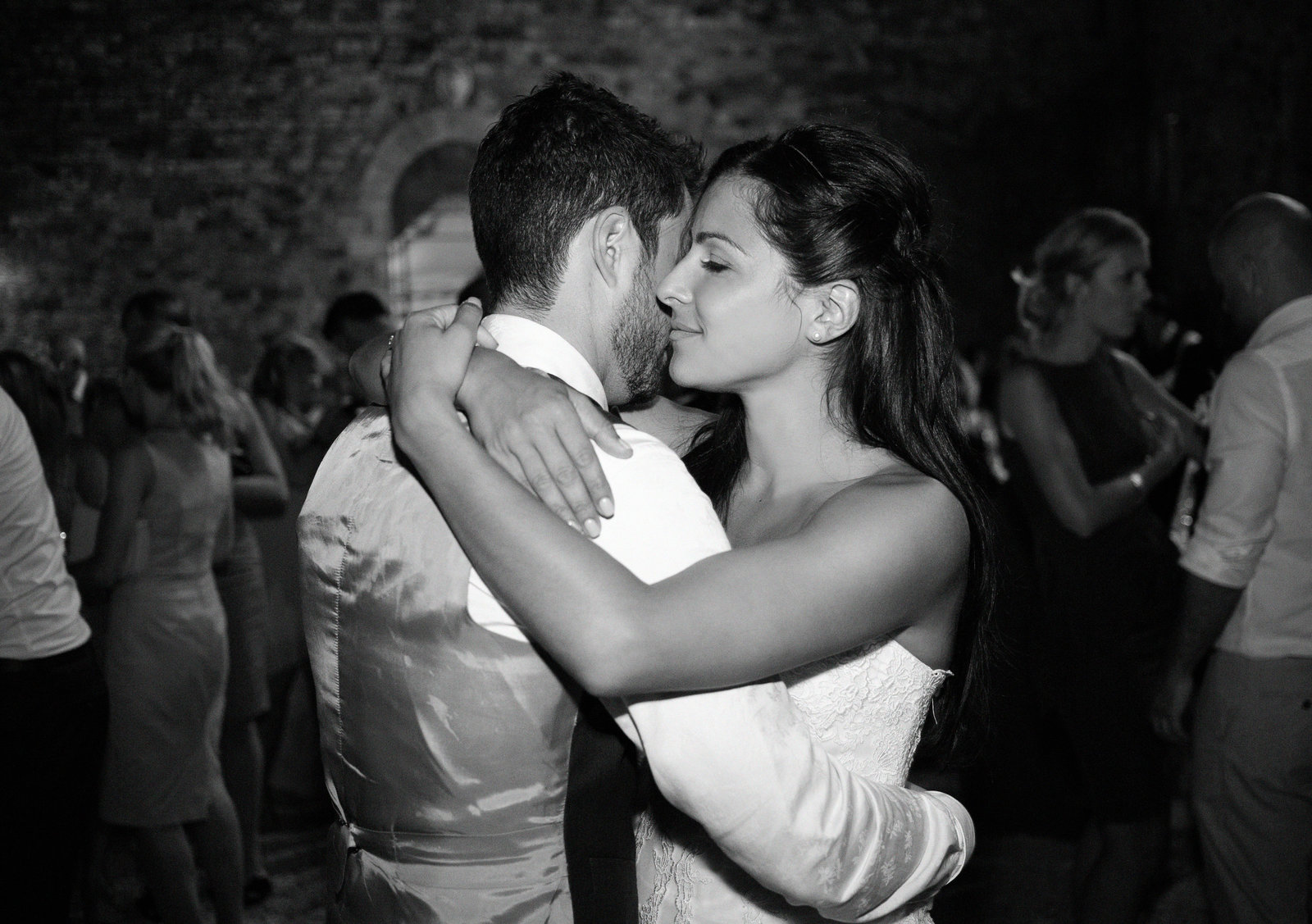Embraced in the moment the bride and groom share an intimate embrace in this beautiful black and white destination wedding photo by Adorlee fo their first dance.
