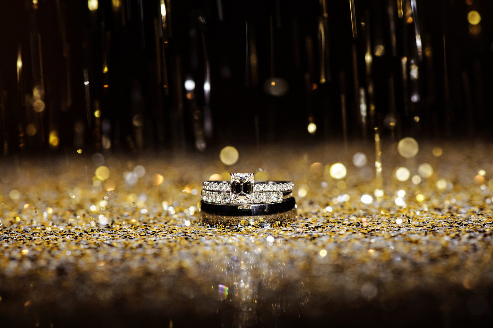 Wedding rings sprinkled with gold glitter at the Chelsea Hotel Wedding.