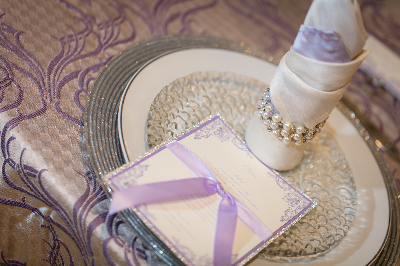 unique napkin fold, menu  and formal place setting
