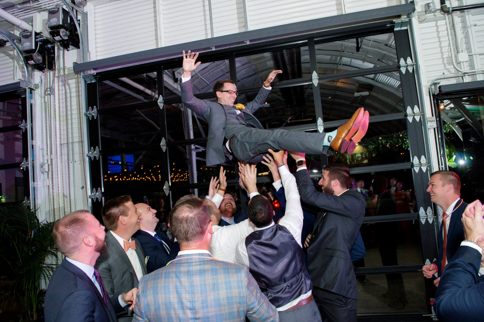the groomsmen throw the groom into the air at coopers hall