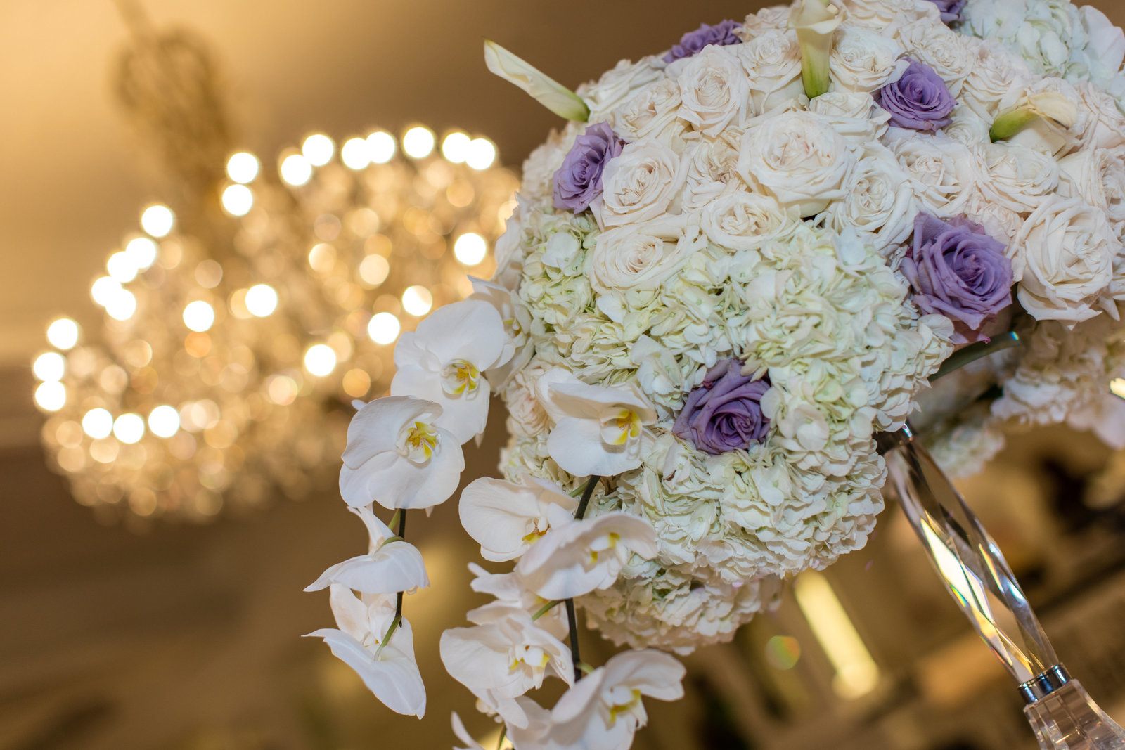 white hydrangeas, purple and ivory roses, lily