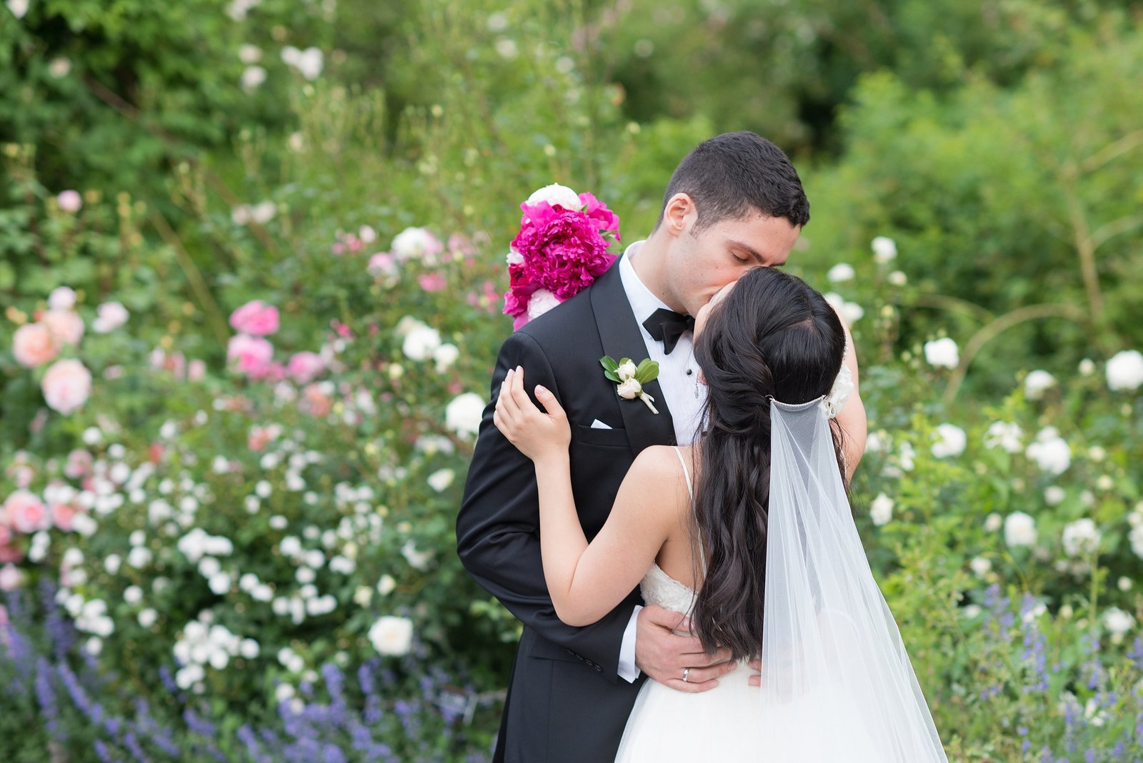 Bride and Groom kissing in Rose Garden at The Brooklyn Botanical Gardens in New York City Photo
