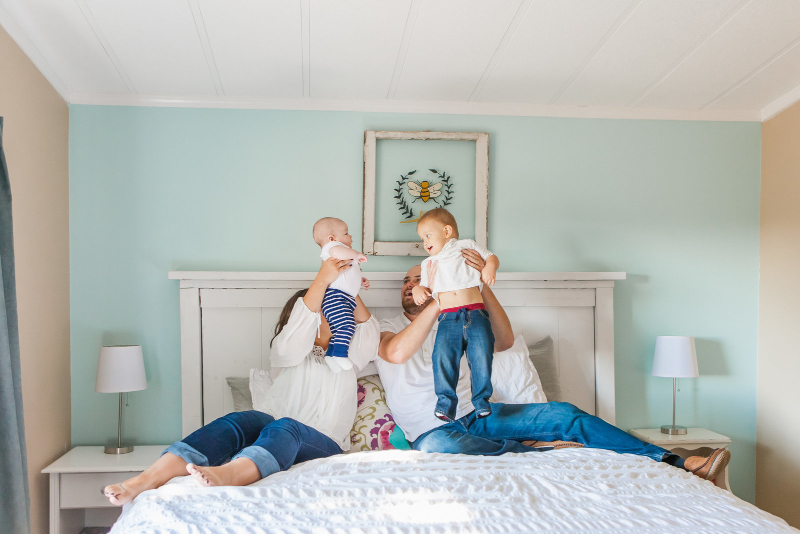 Cottonwood CA lifestyle family session family of 4 playing on bed