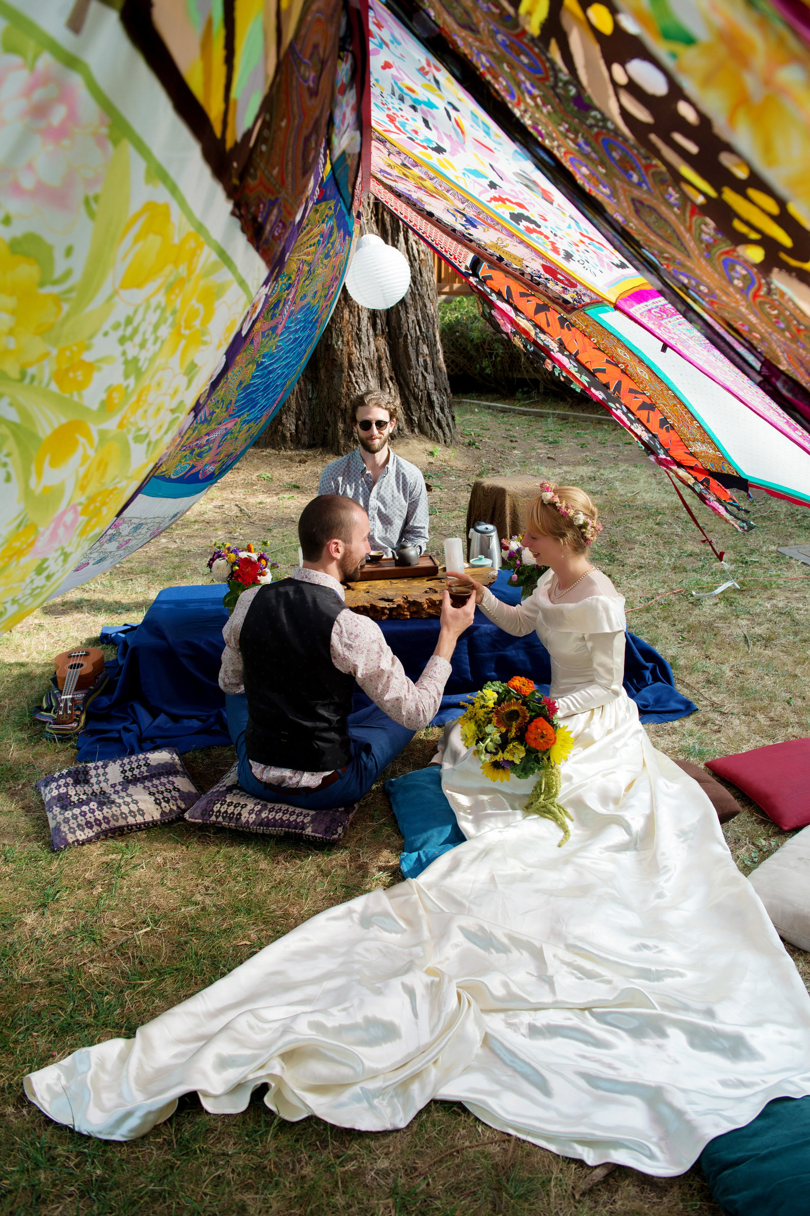 wedding day tea ceremony in colorful tent