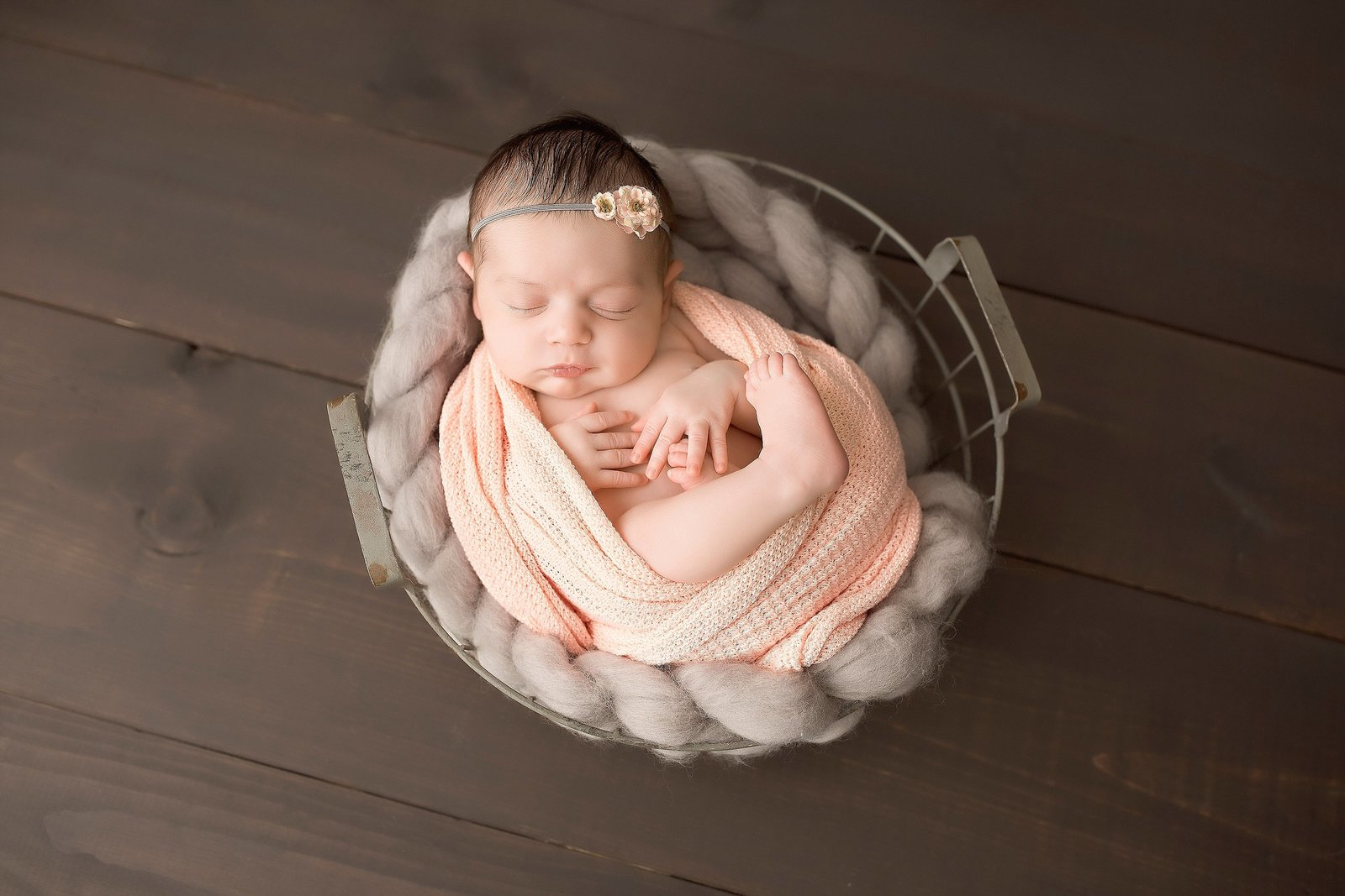 Sleeping baby girl in wire basket