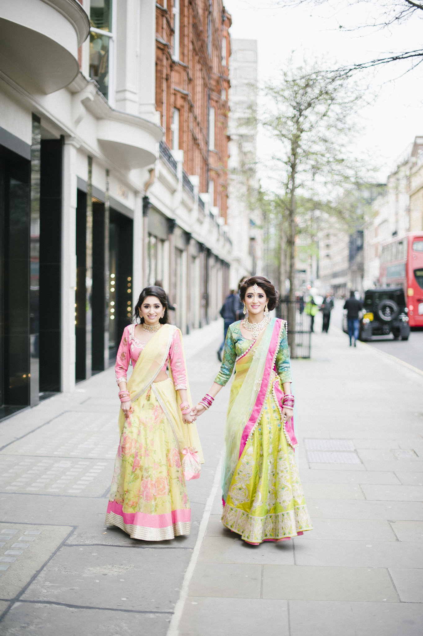 bride and her sister walking london mayfair