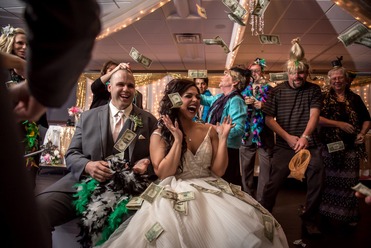 bride and groom laughing dollar dance