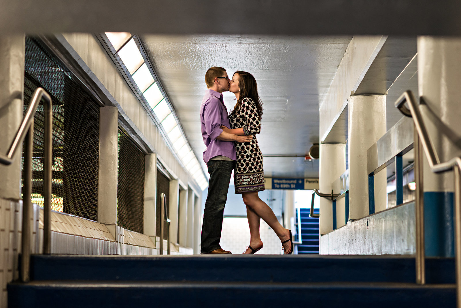 A bride to be kisses her fiance in the subway in Philly.