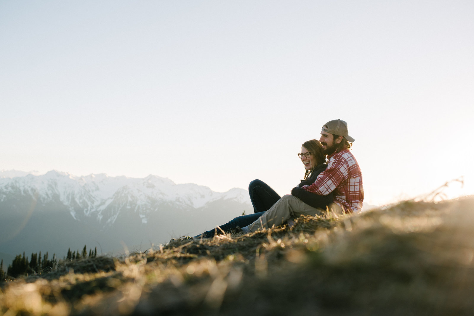 couple sitting on mountain top