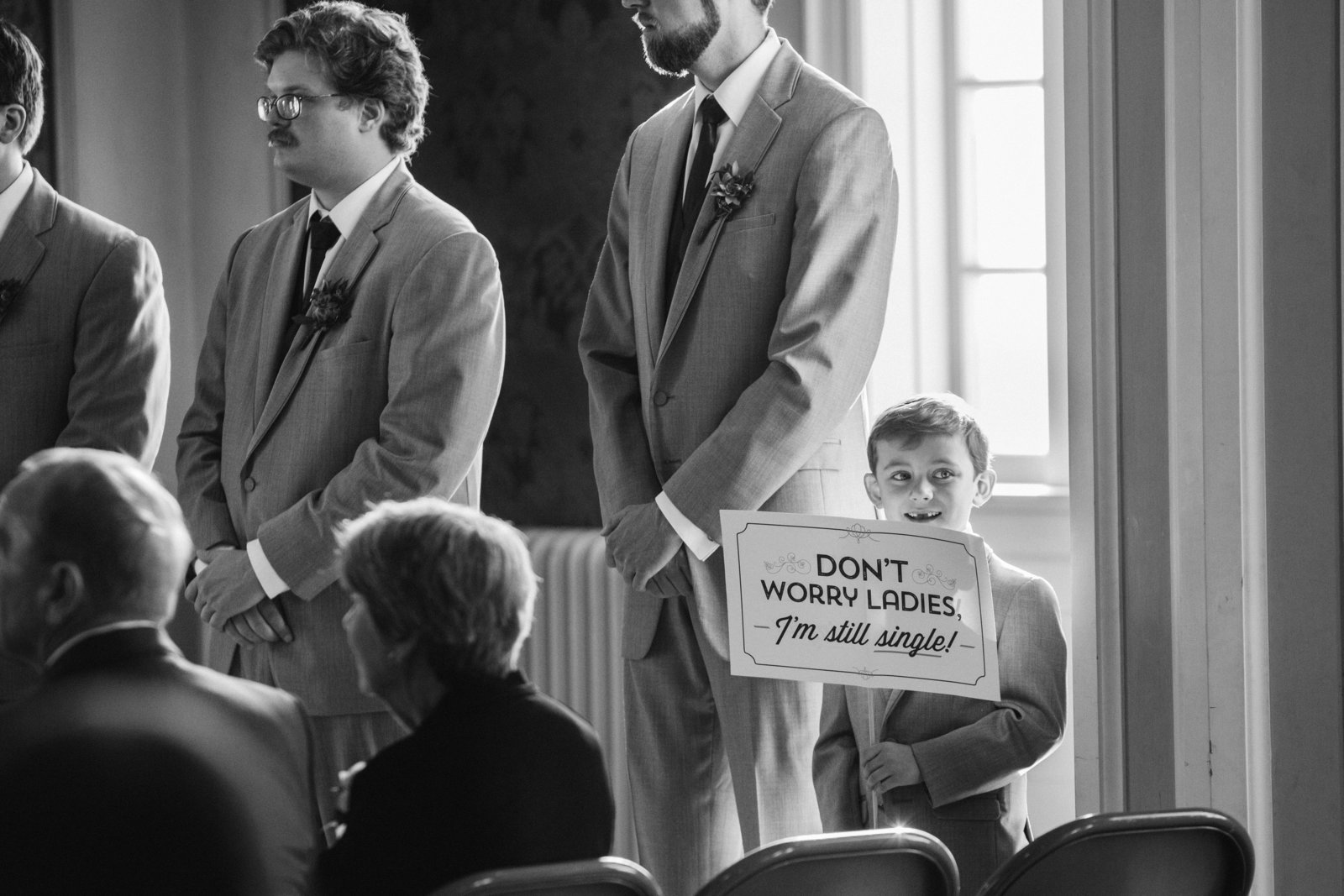 Kid holding sign at wedding