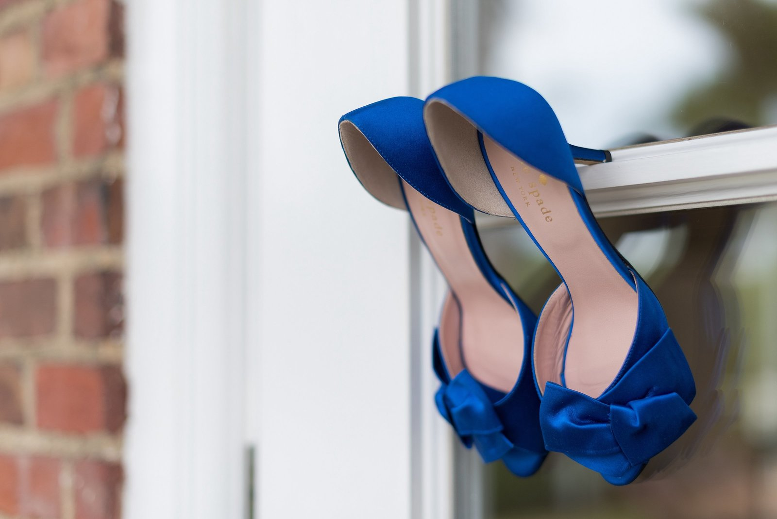 Royal Blue Kate Spade Shoes Hanging on Window photo