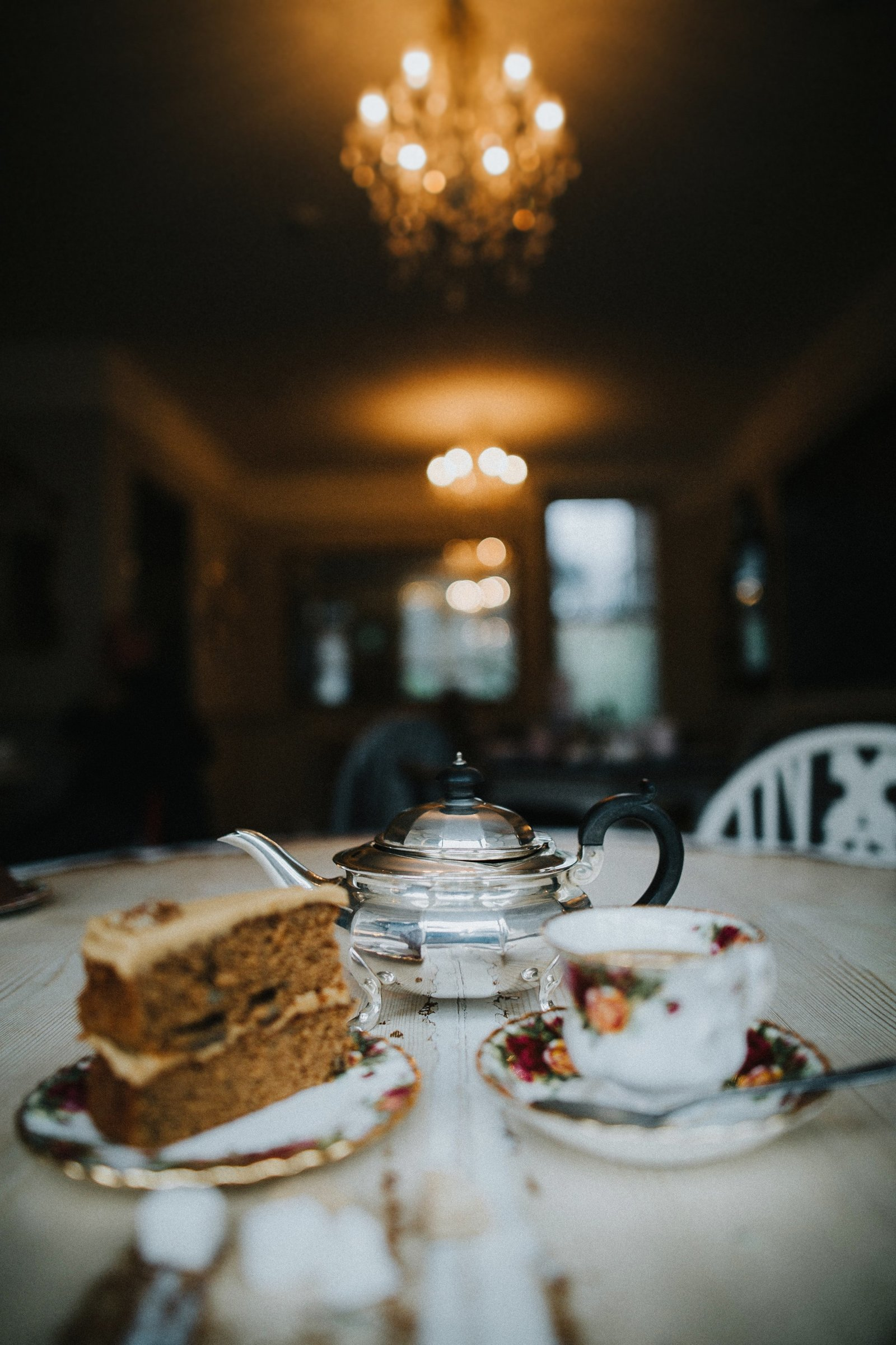 Teapot, teacup and cake set out on table at Baldry's Tearoom in Grasmere Village, The Lake District