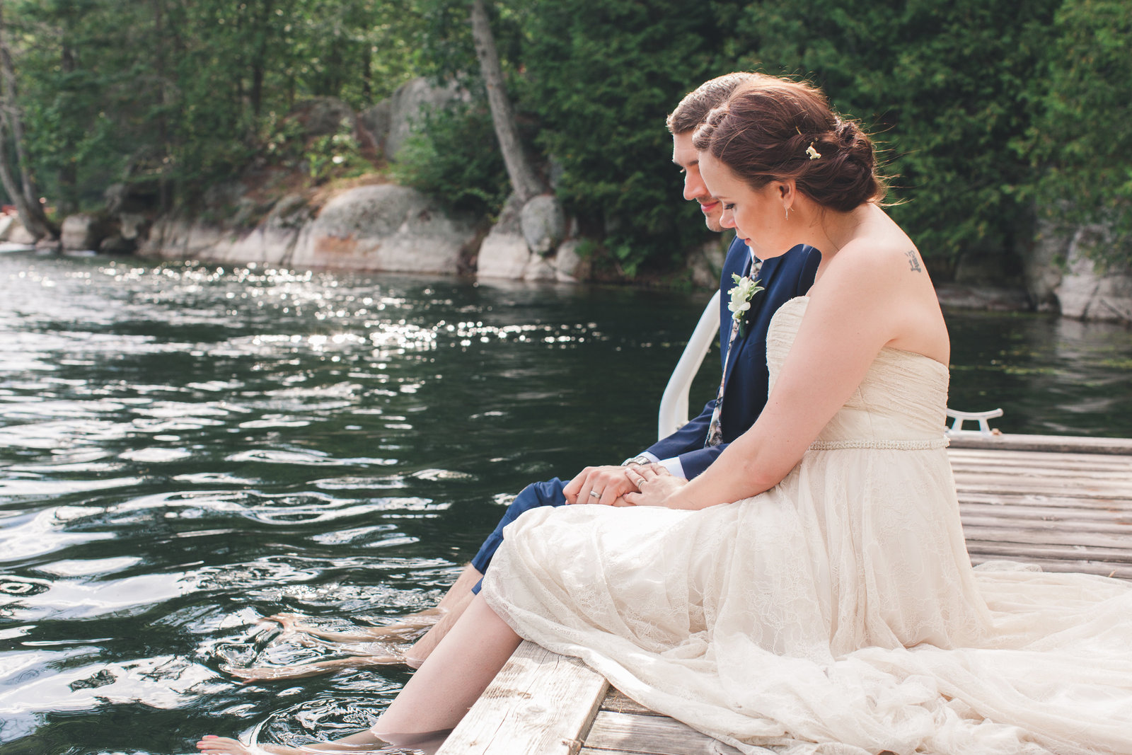 bride and groom married on the dock at the cottage