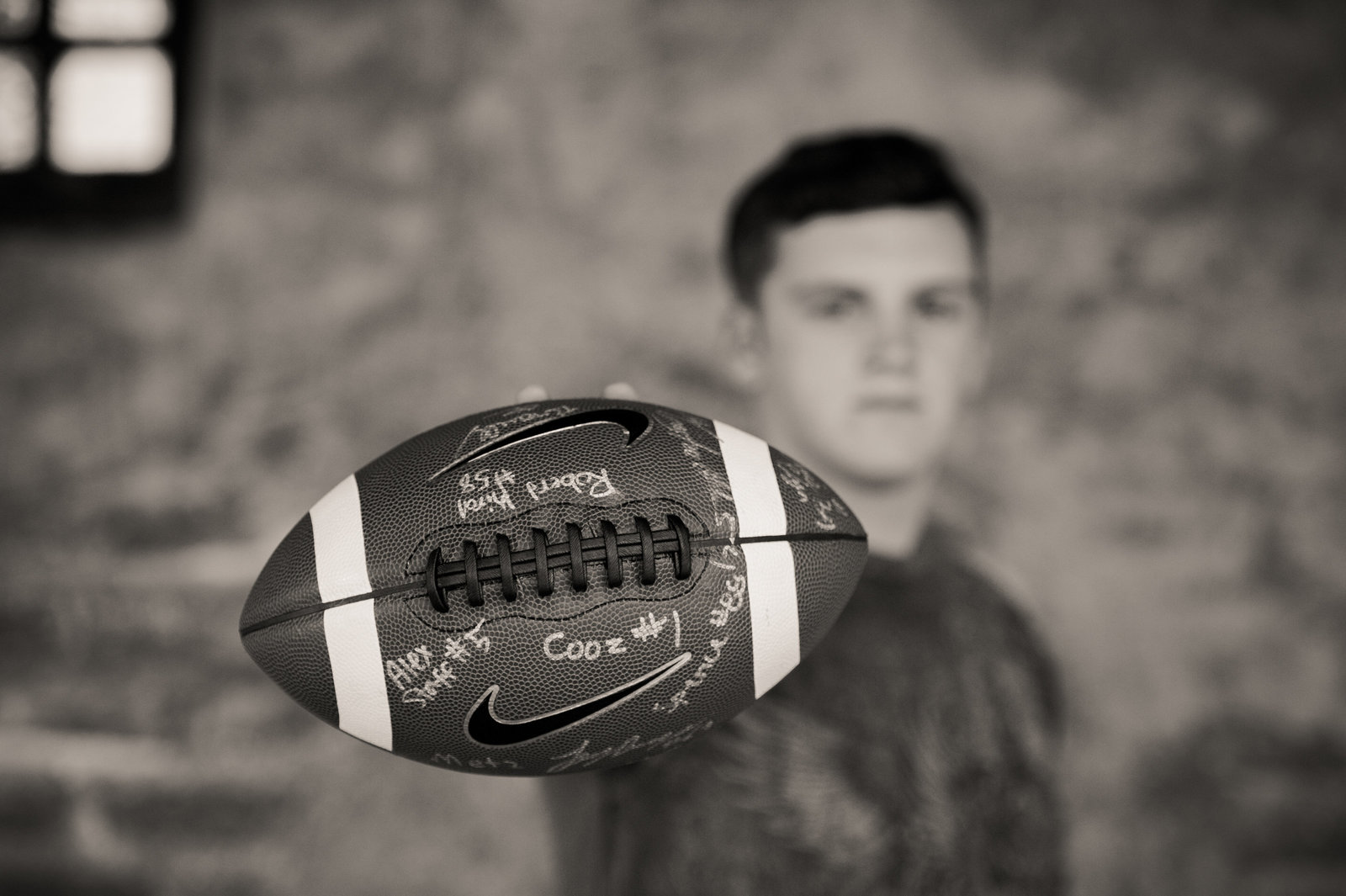 teenager with football at Mission in San Juan Capistrano