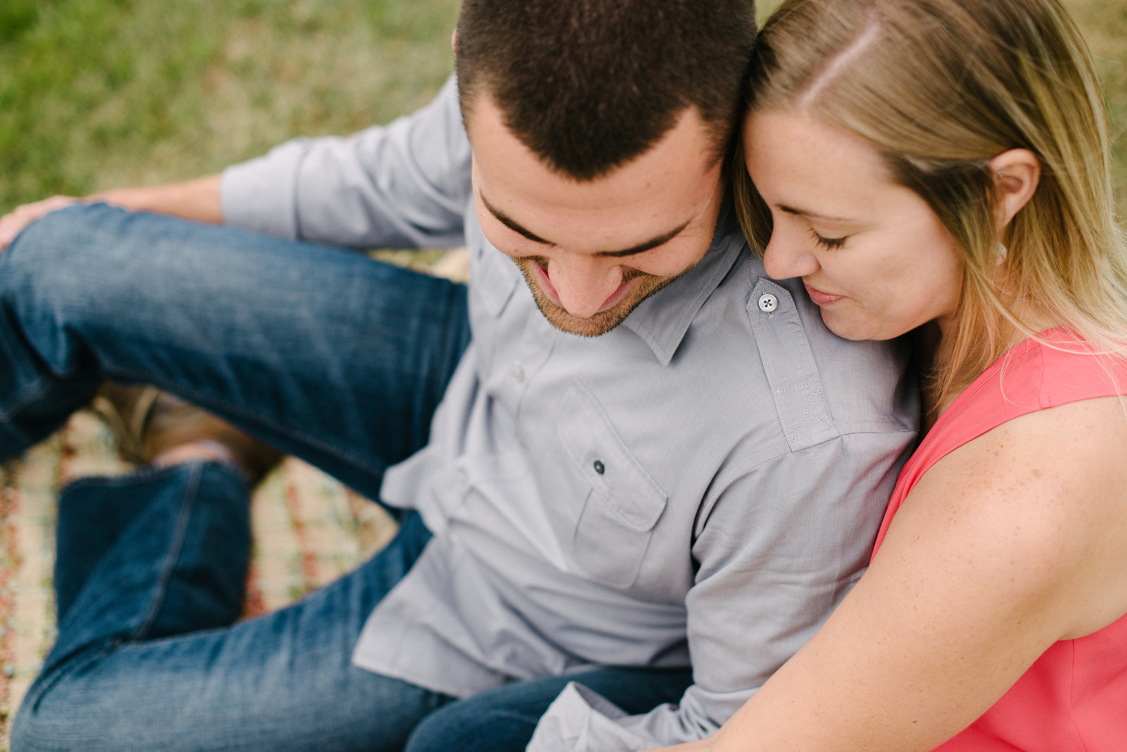 Guildford Lake OH engagement session couple sitting in grass