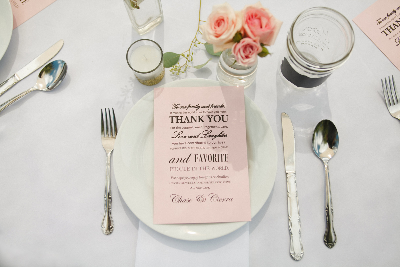 Beautiful place setting with pink menu at wedding reception | Susie Moreno Photography