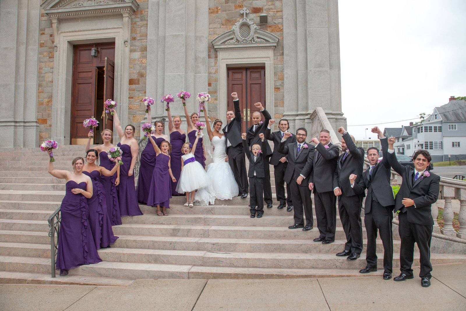 wedding party on front steps of church