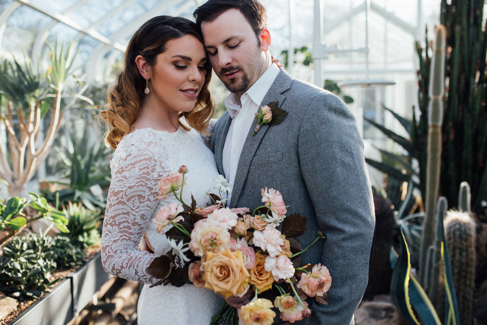 Elopement couple embrace while holding her wedding bouquet in Seattle WA
