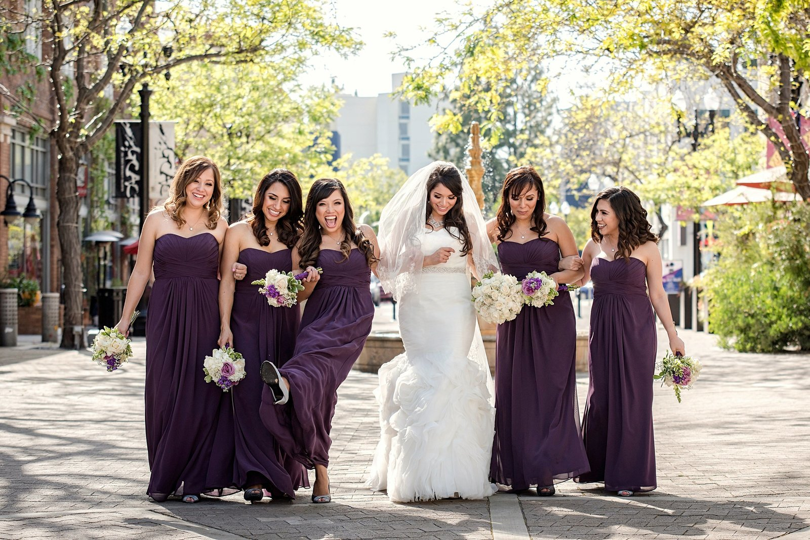 bride with bridesmaids having fun