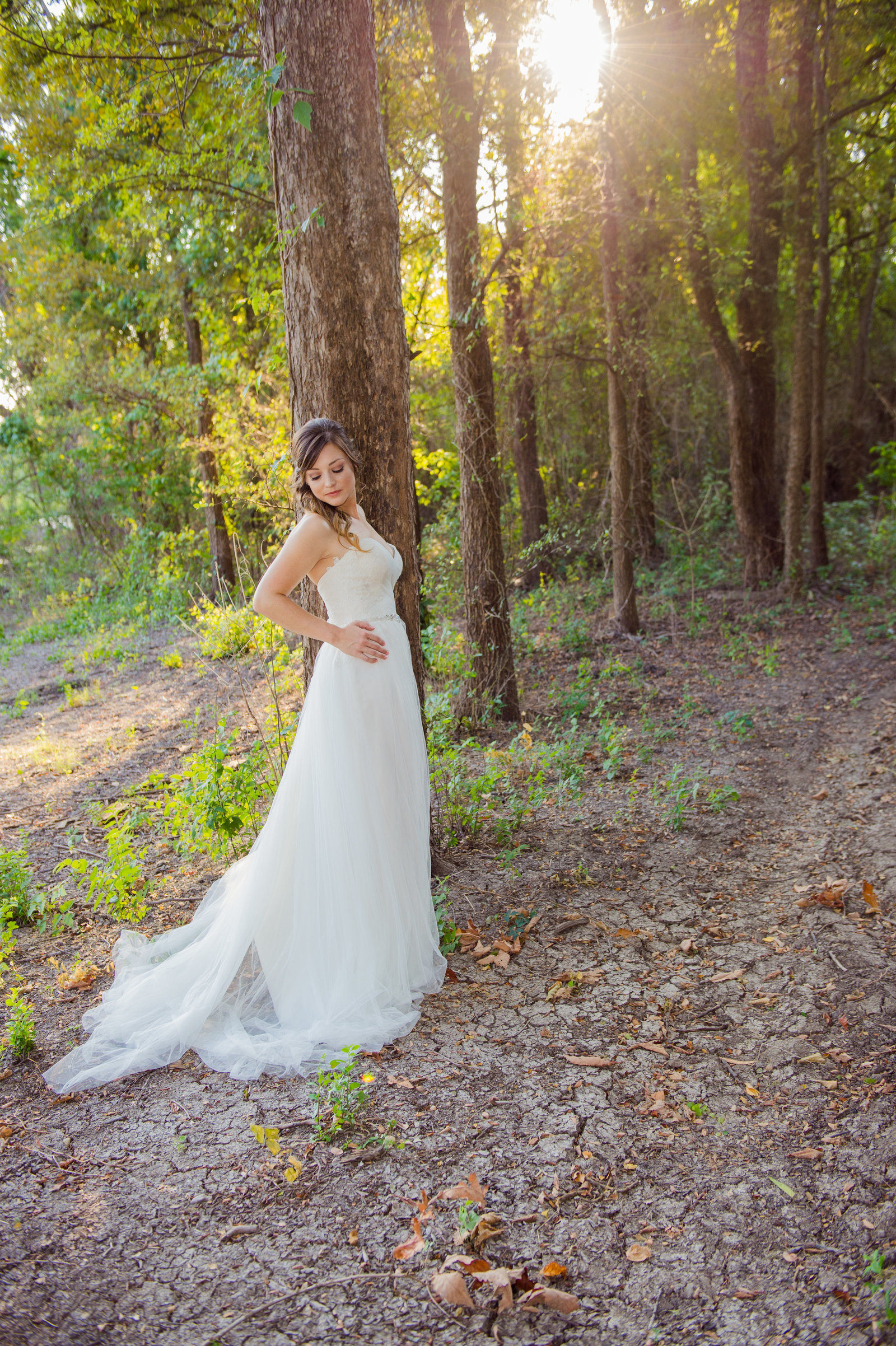 Bride in the woods by Brittany Barclay Photography