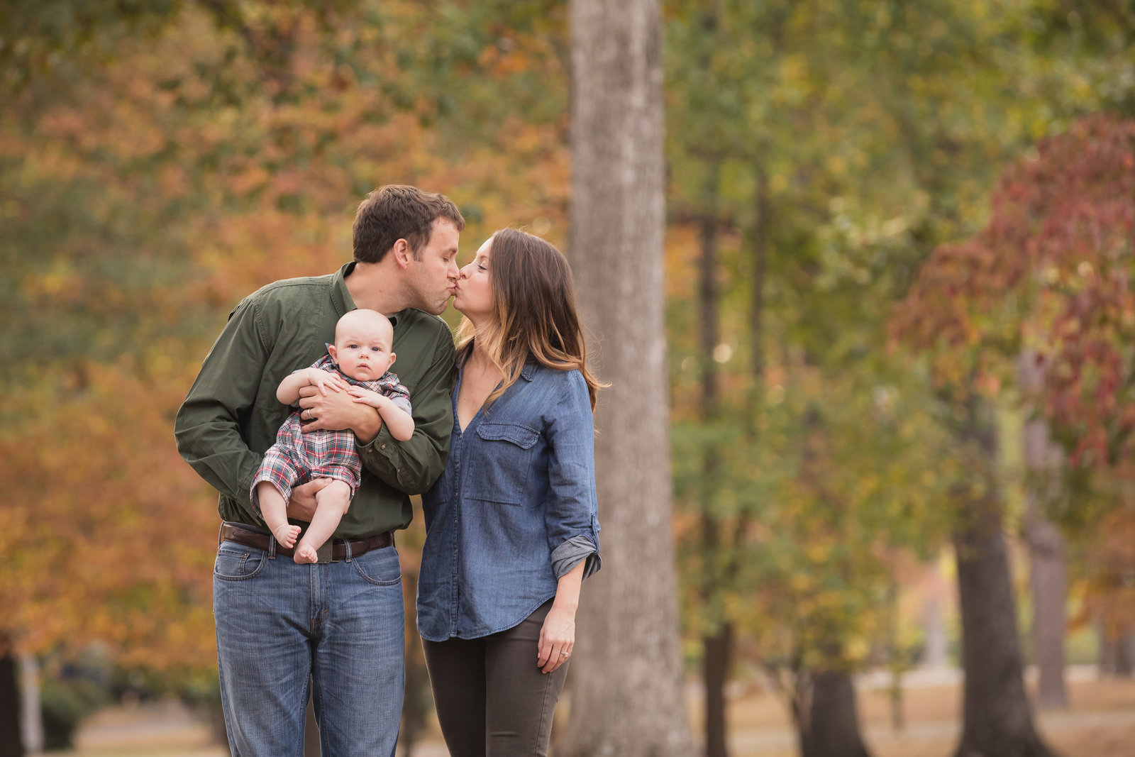 Colorful family portrait in a fall setting