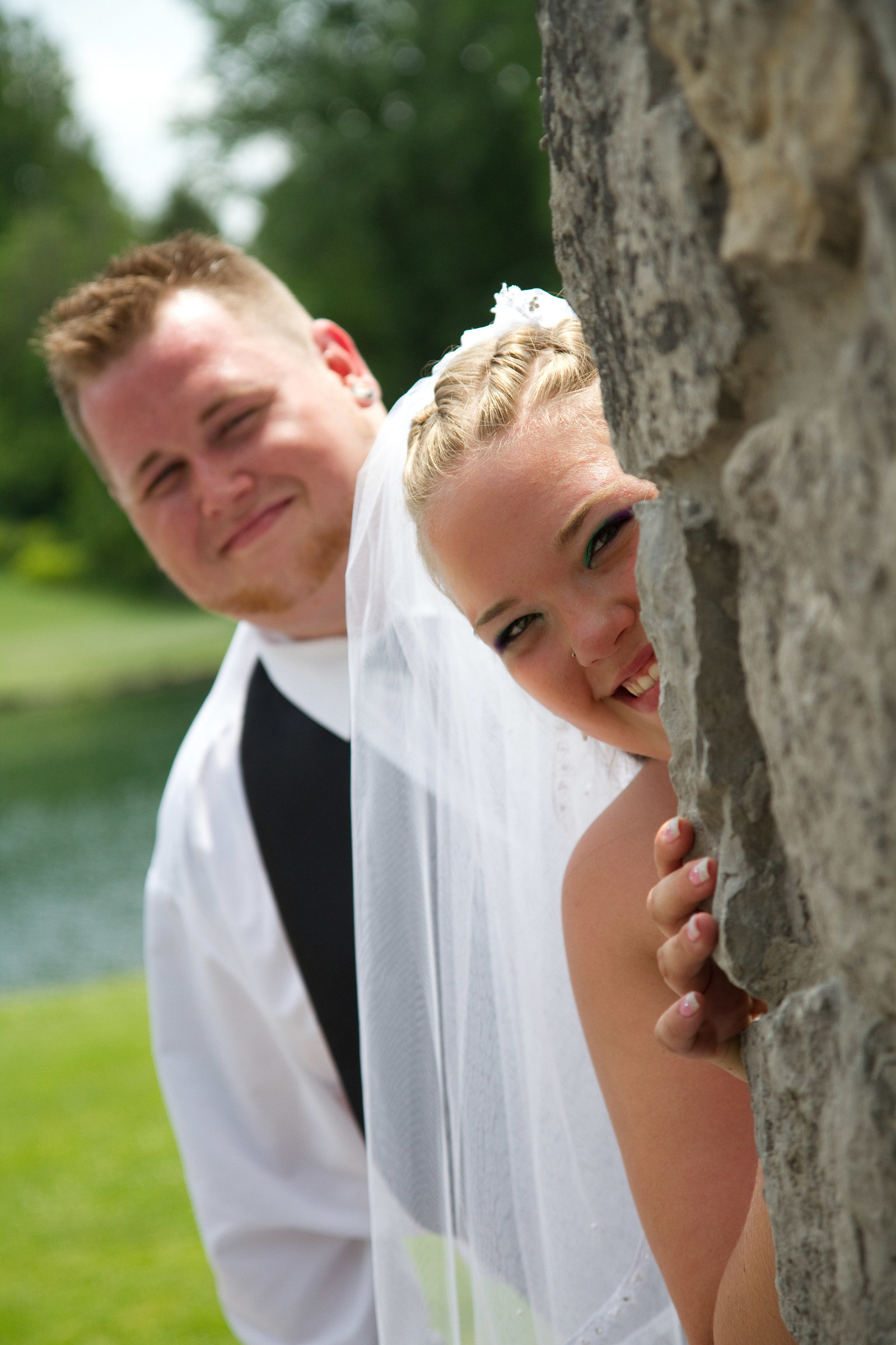 wedding photography bride and groom hiding