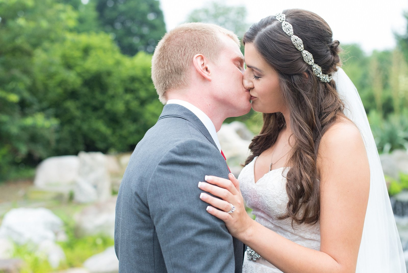 Bride and Groom Kissing at Orange County Arboretum in Campbell Hall, New York Photo