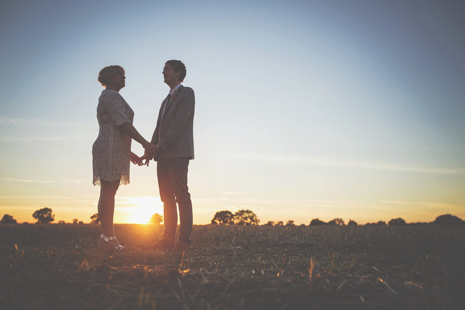 wedding photography of a couple in a field at sunset in Norfolk