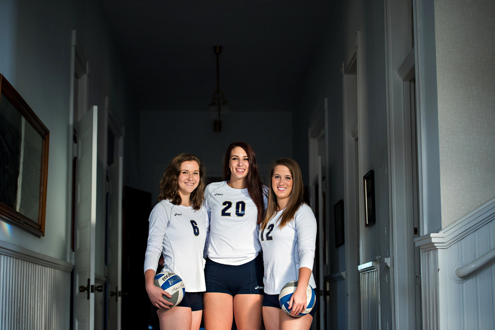College volley ball athletes pose.