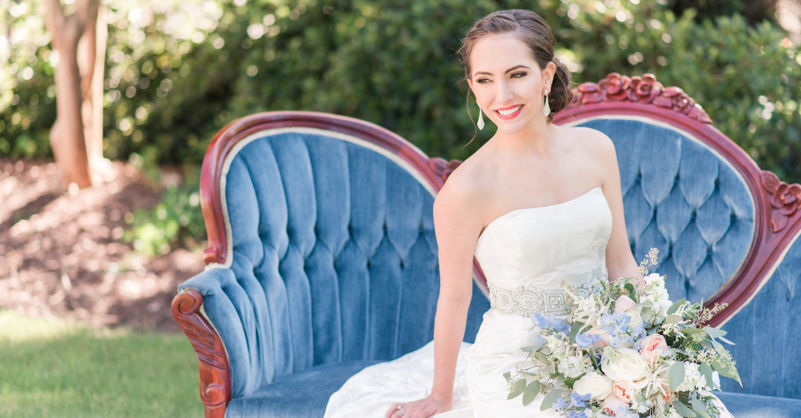 bridal portait on blue vintage couch at moca virginia beach by norfolk wedding photographer