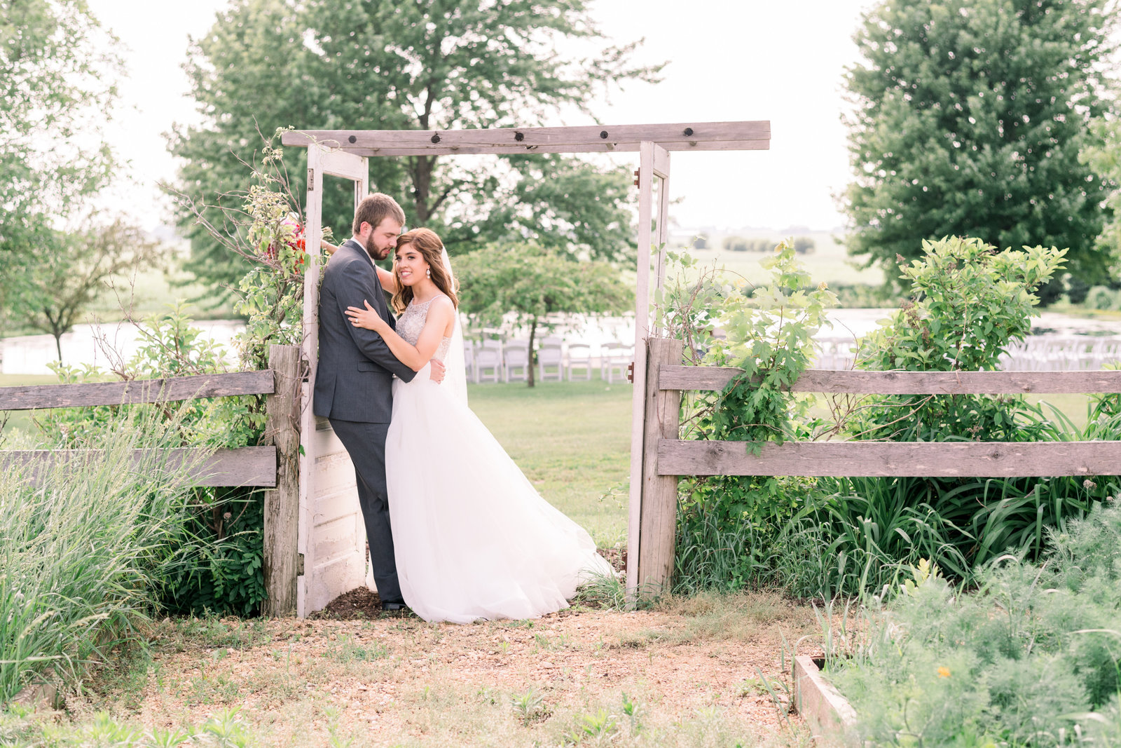 Bride and groom near the pond at The Barn at Brophy Creek Dewitt, Iowa for a summer outdoor wedding