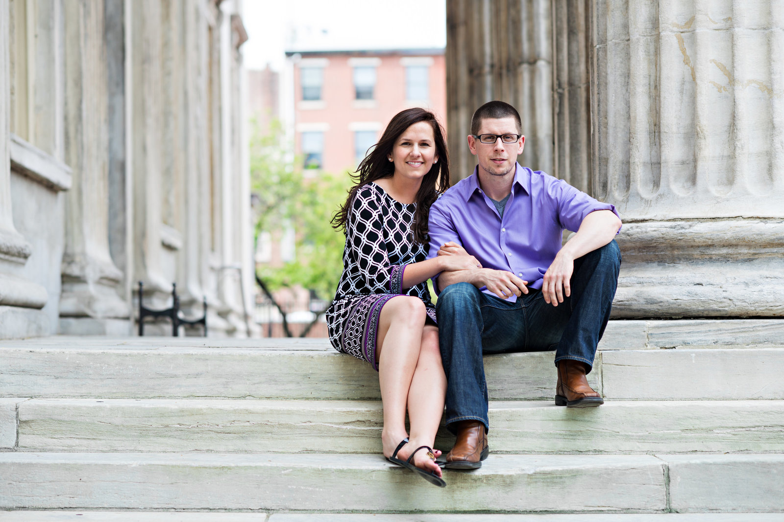 A cute couple on the steps of the first bank in philly.