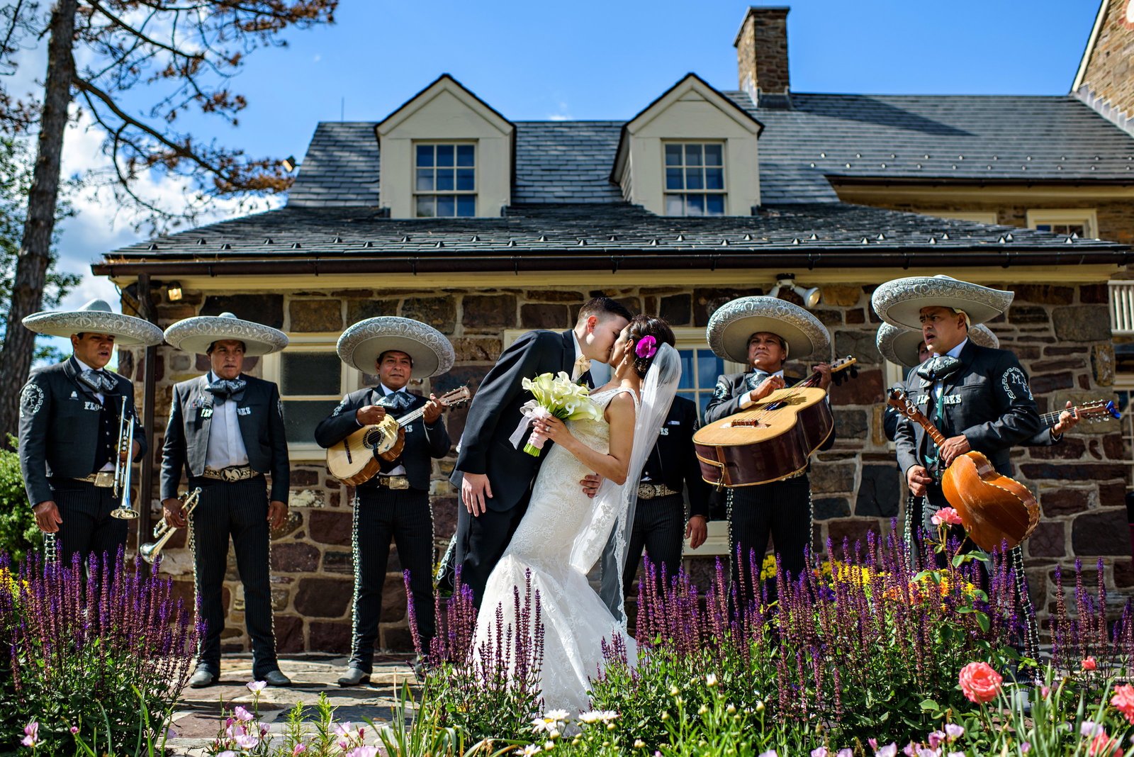 A mariachi band serenade a bride and groom on their wedding day at Pearl S Buck Estate.
