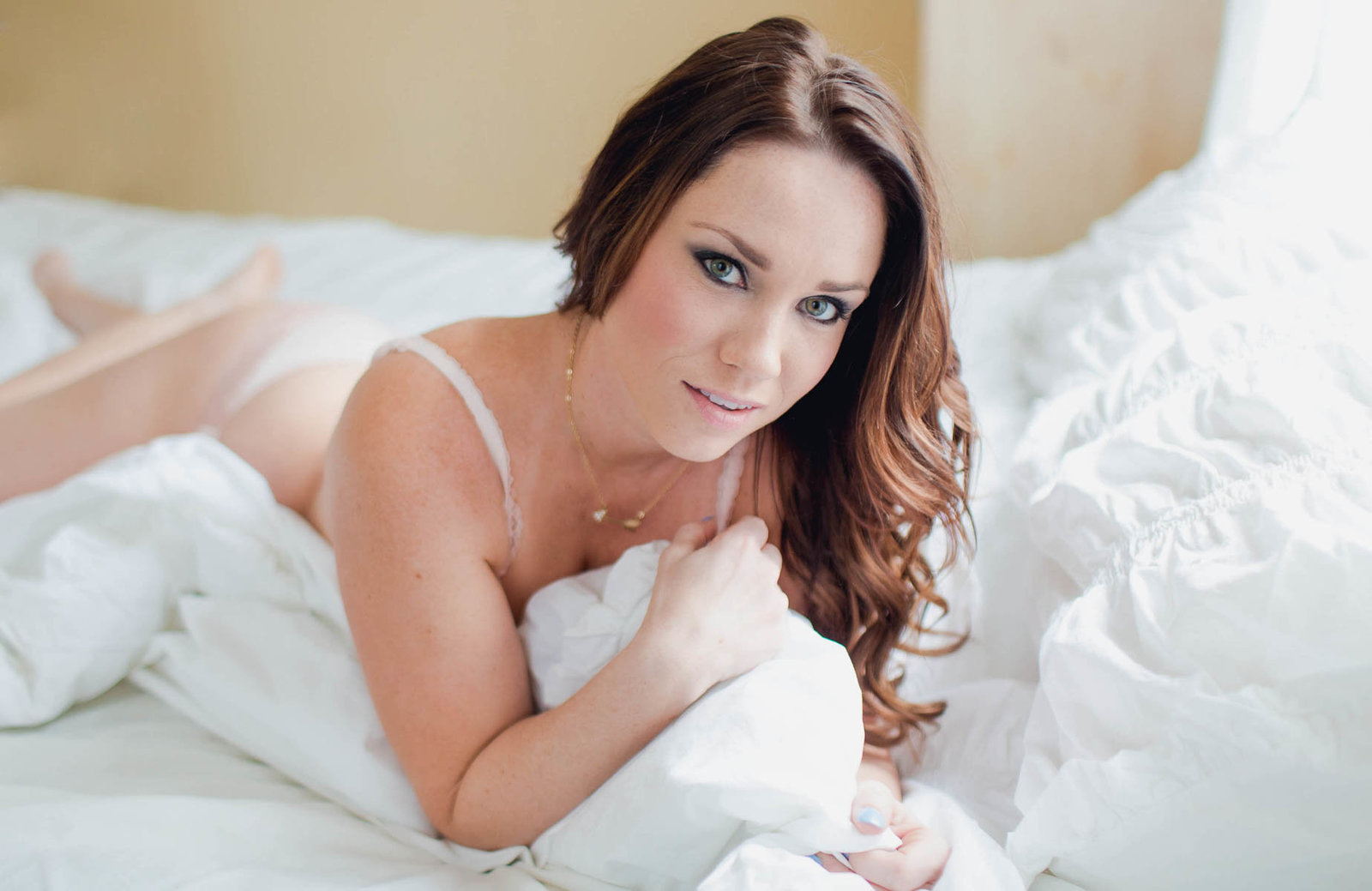 Ms L wears pink lingerie in bed, Boudoir Photography, Charleston, SC