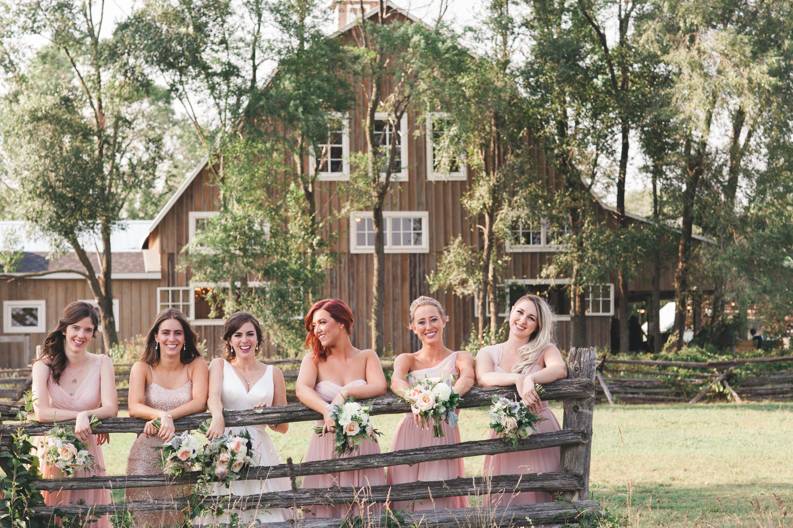 bridesmaids in pink at Stonefields heritage farm