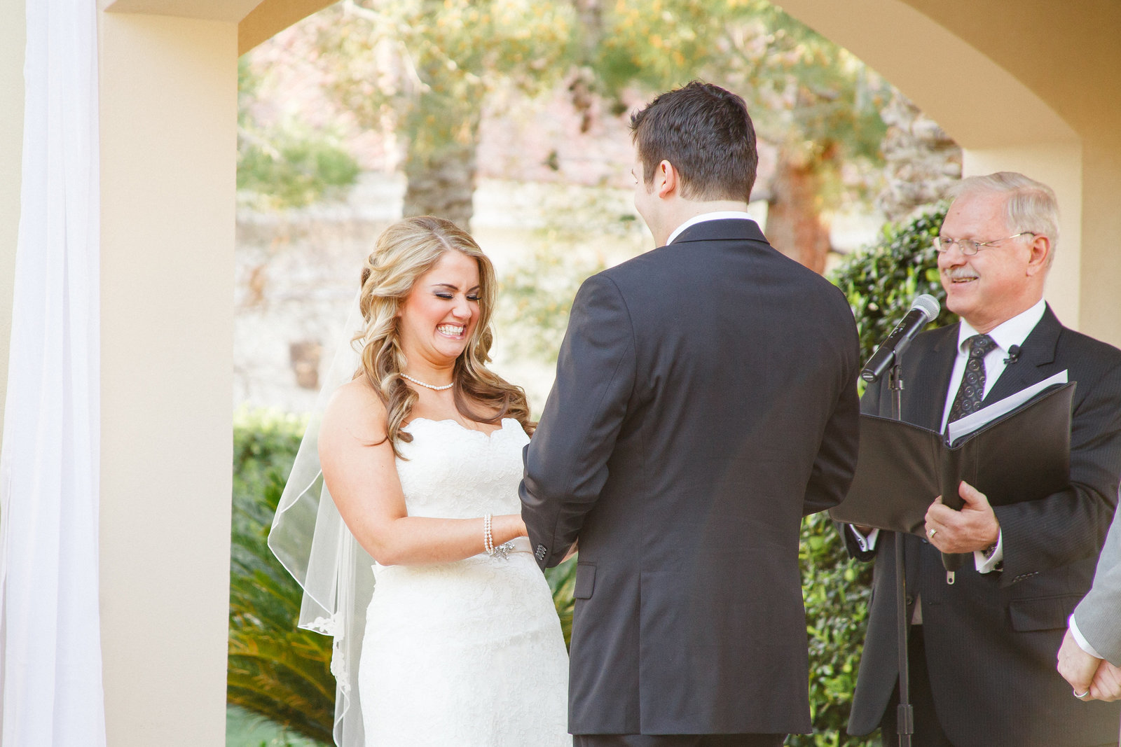 Photo of bride and groom exchanging vows at their outdoor wedding ceremony | Susie Moreno Photography