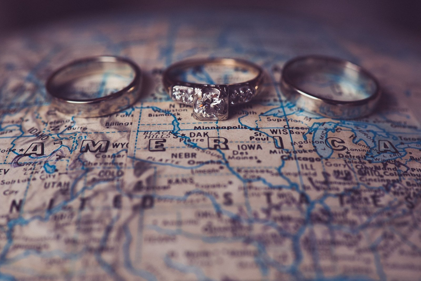 wedding rings on a globe