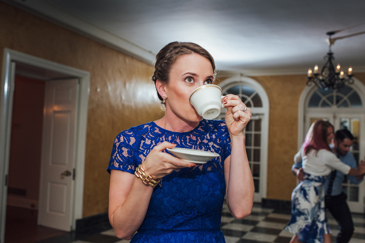 brides maid has a drink during wedding reception at brantwyn estates