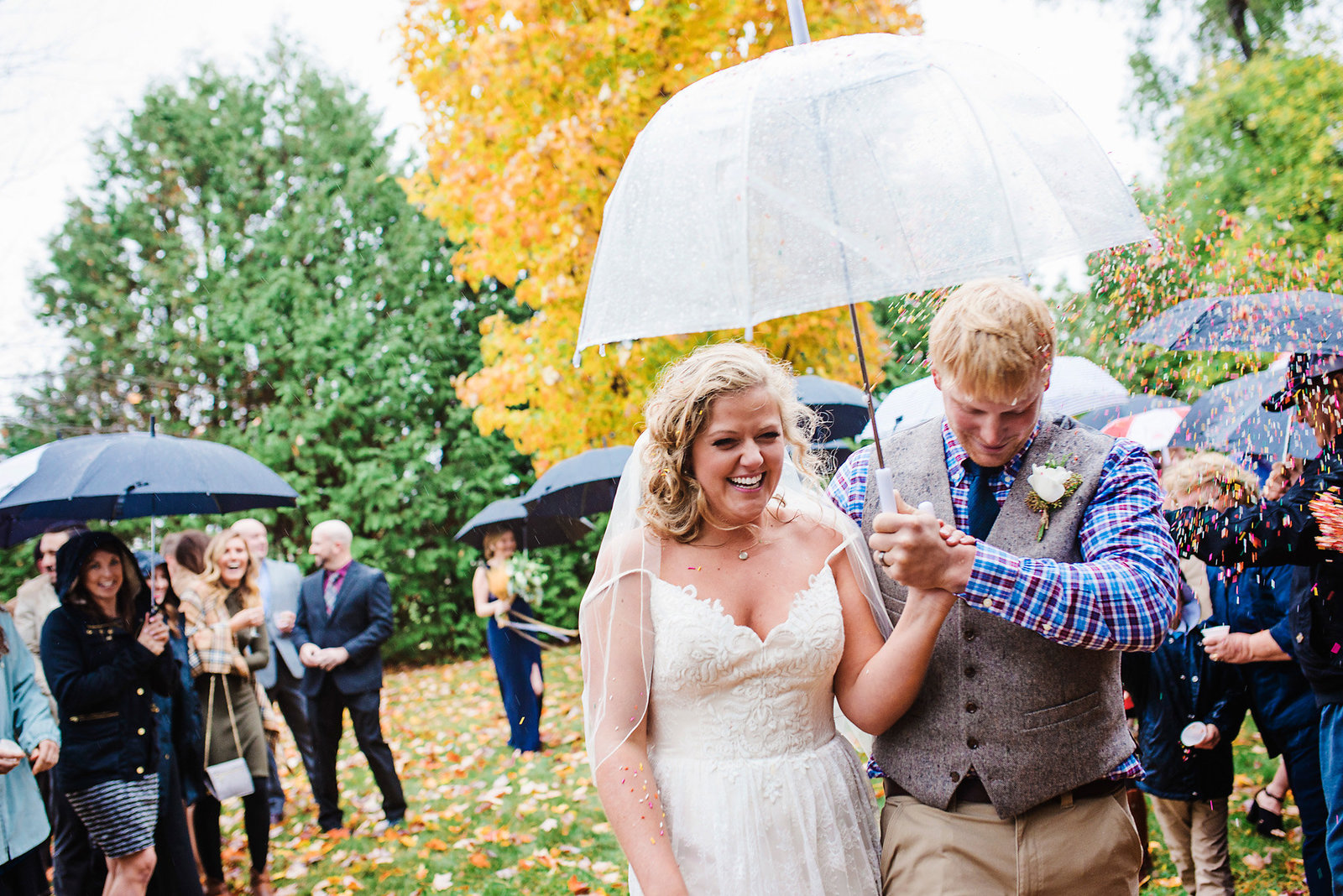 rainbow sprinkles confetti, rainy wedding, clear umbrella, bride and groom exit, fall wedding in Vermont