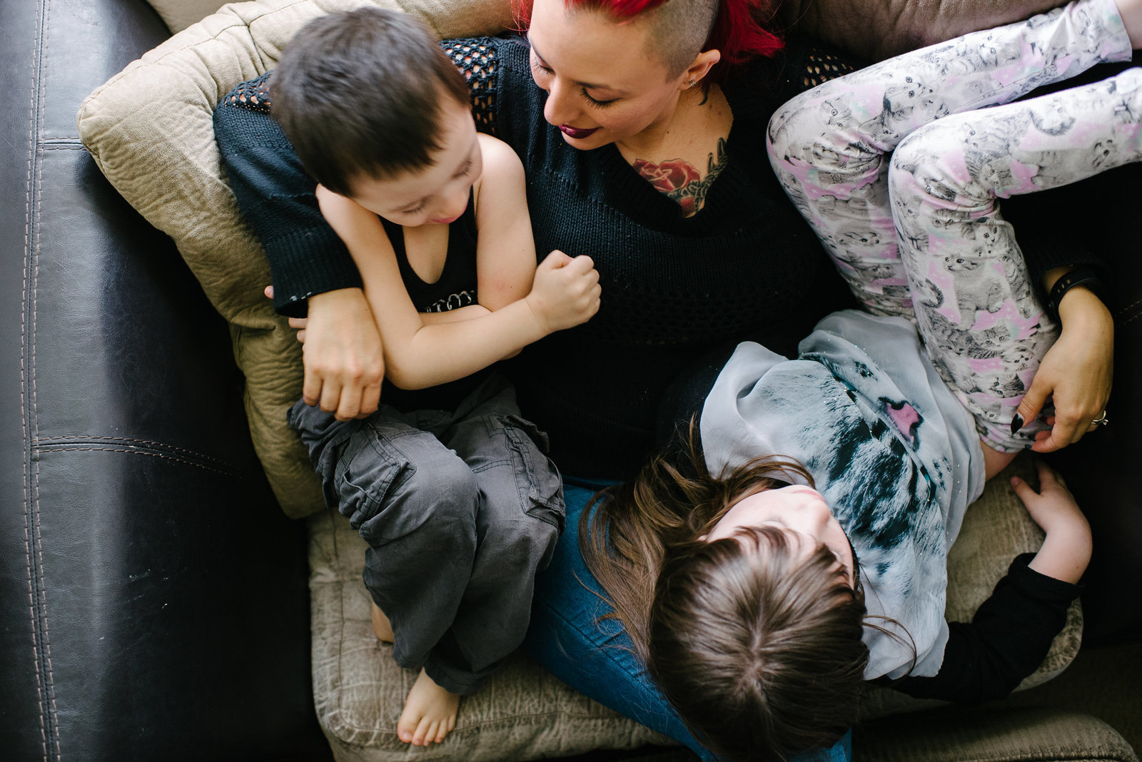mom sitting on couch with son and daughter