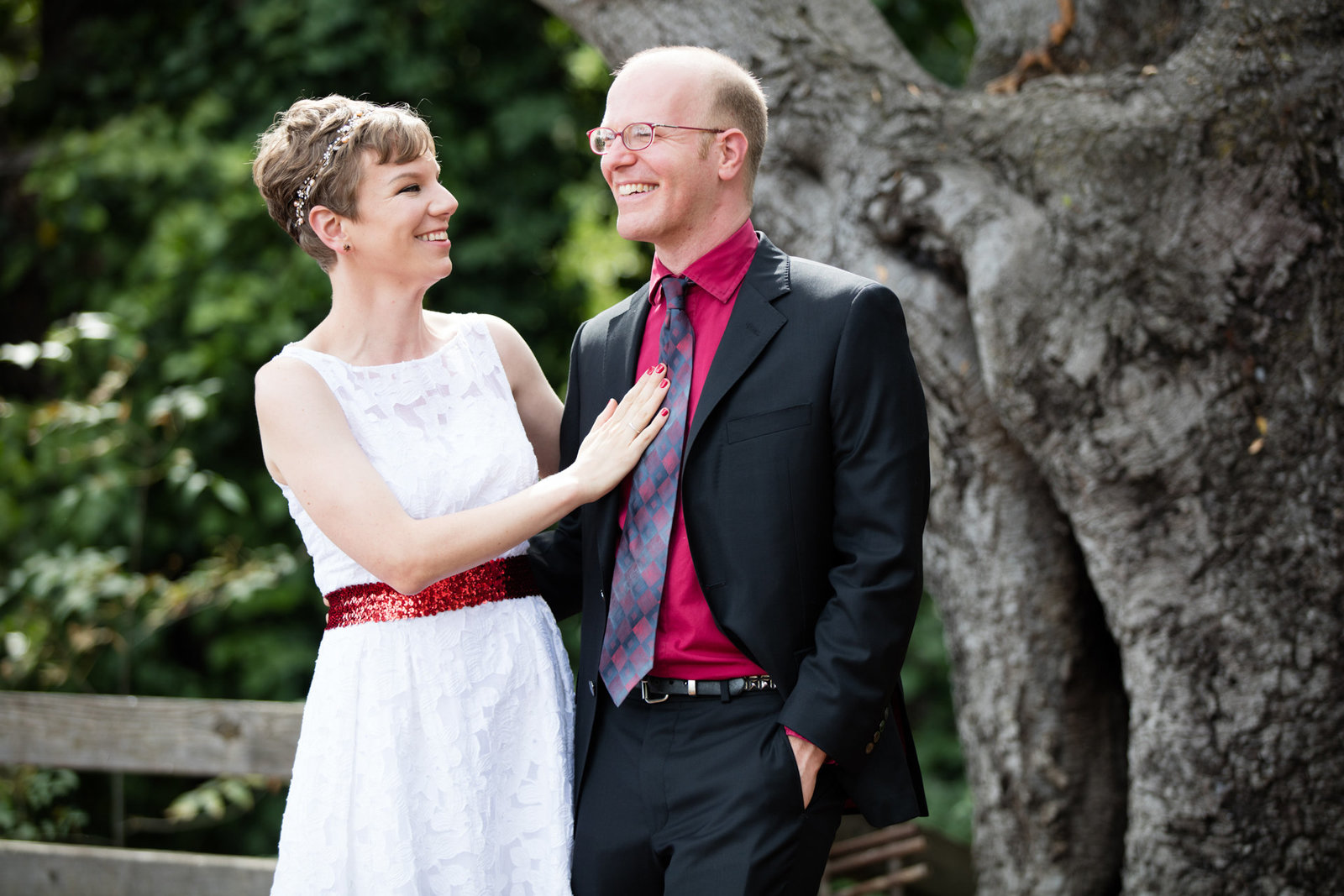 Bride and groom smile and laugh in portrait at stunning northern california wedding