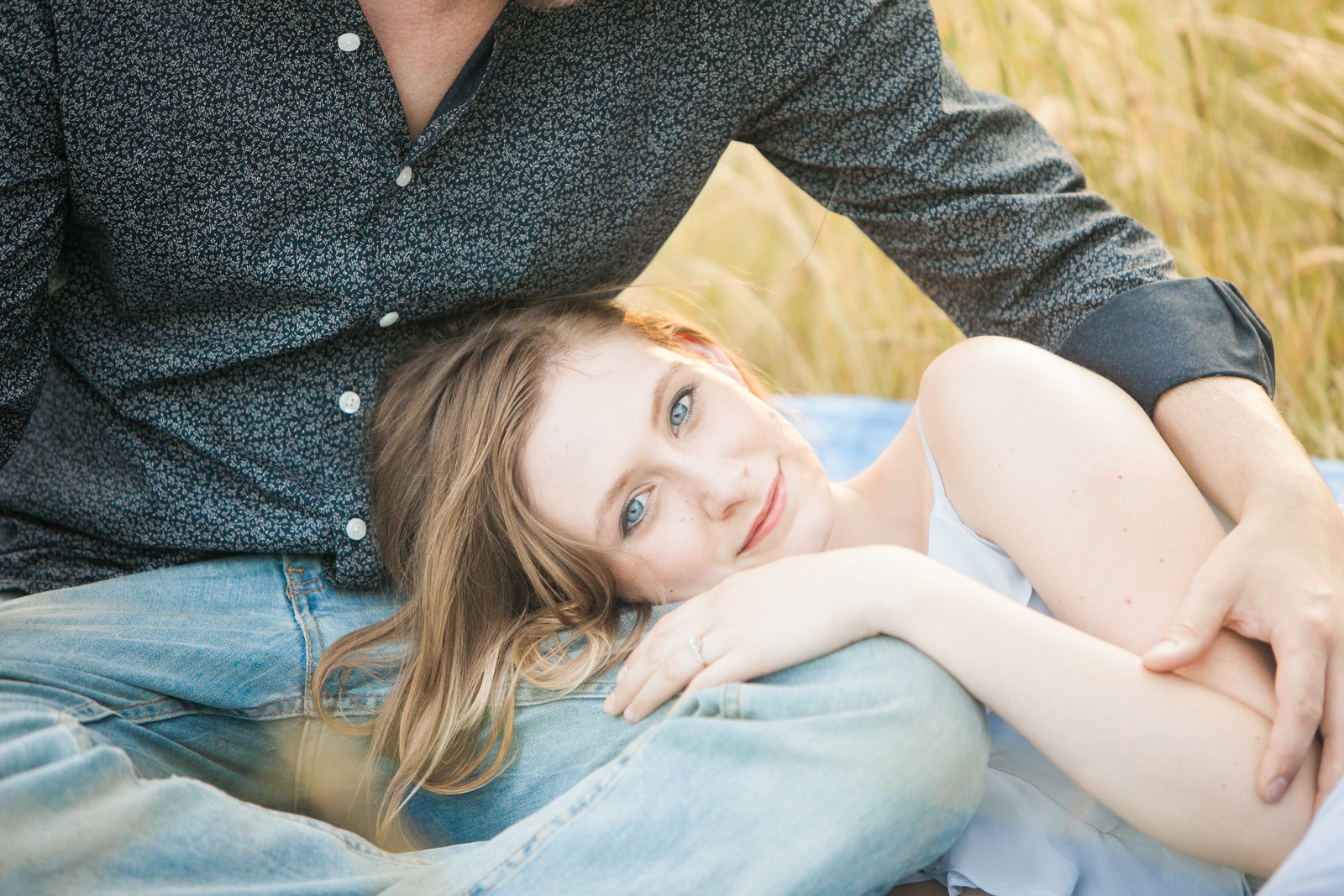 maddi and micah engagement session in outdoor field in cary nc.