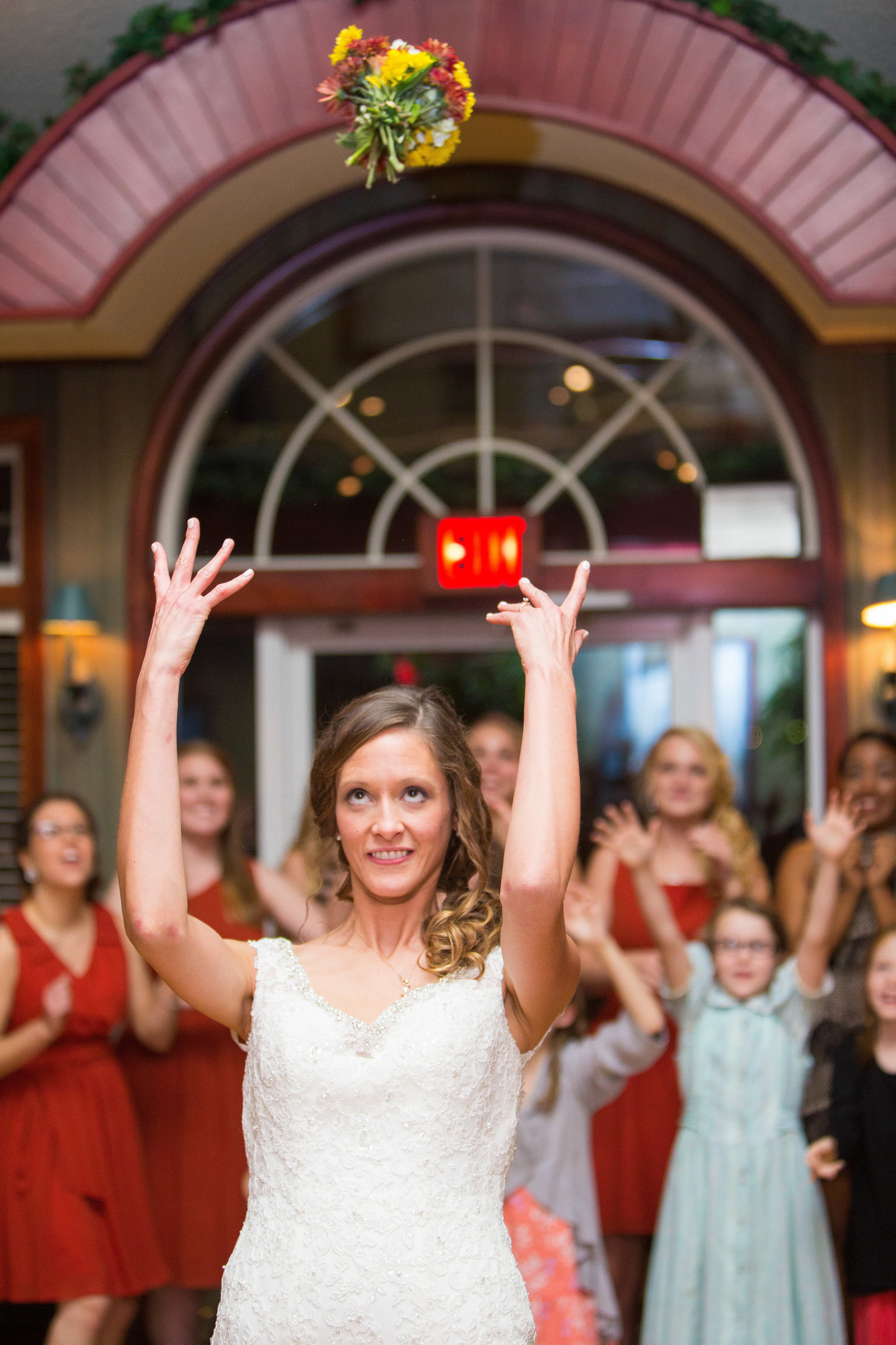 wedding photography reception bouquet toss