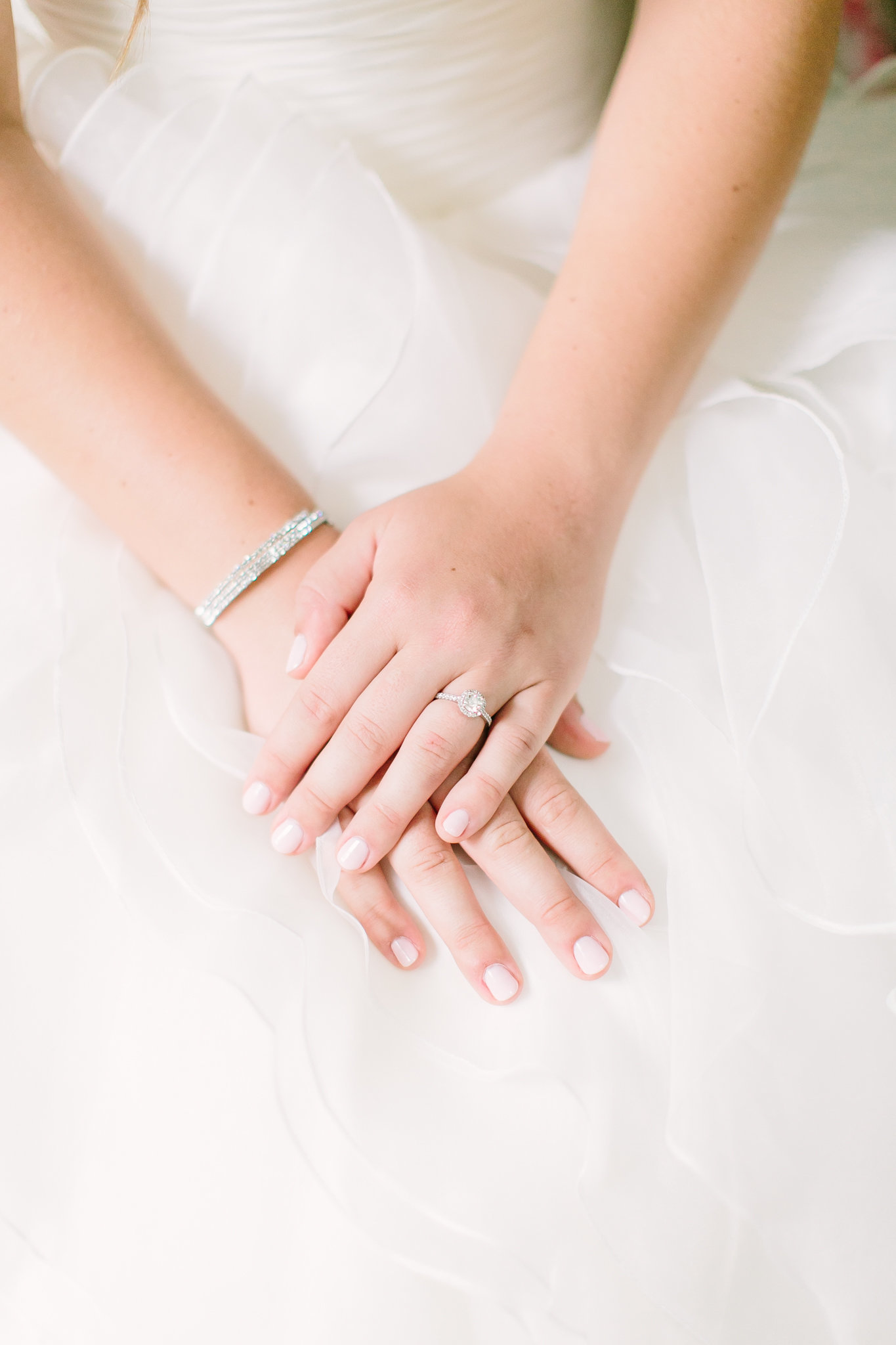 brides hands with diamond bracelet and ring