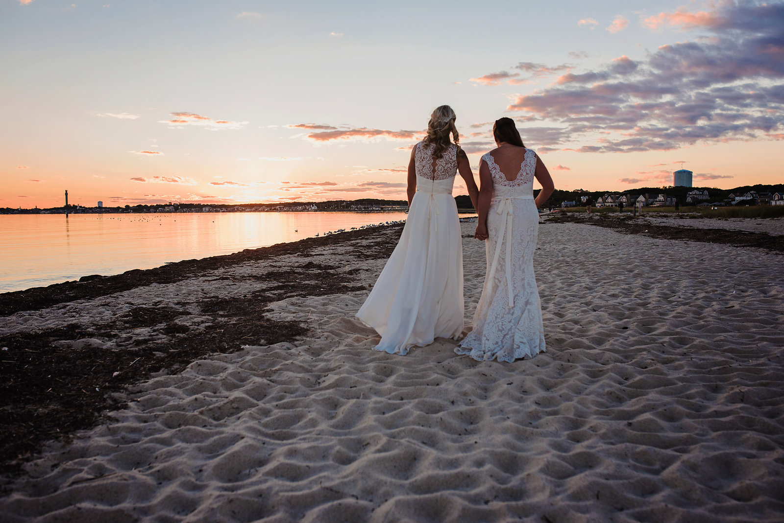 Same sex wedding, Cape Cod wedding, two brides, walking on beach at sunset