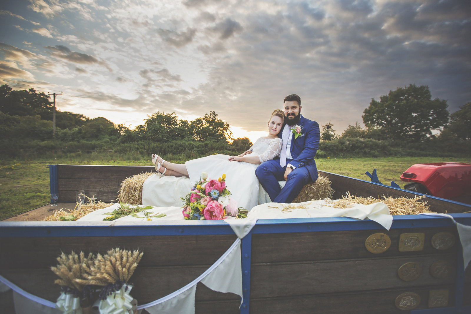 Wedding photography by Jessica elisze couple on hay bales