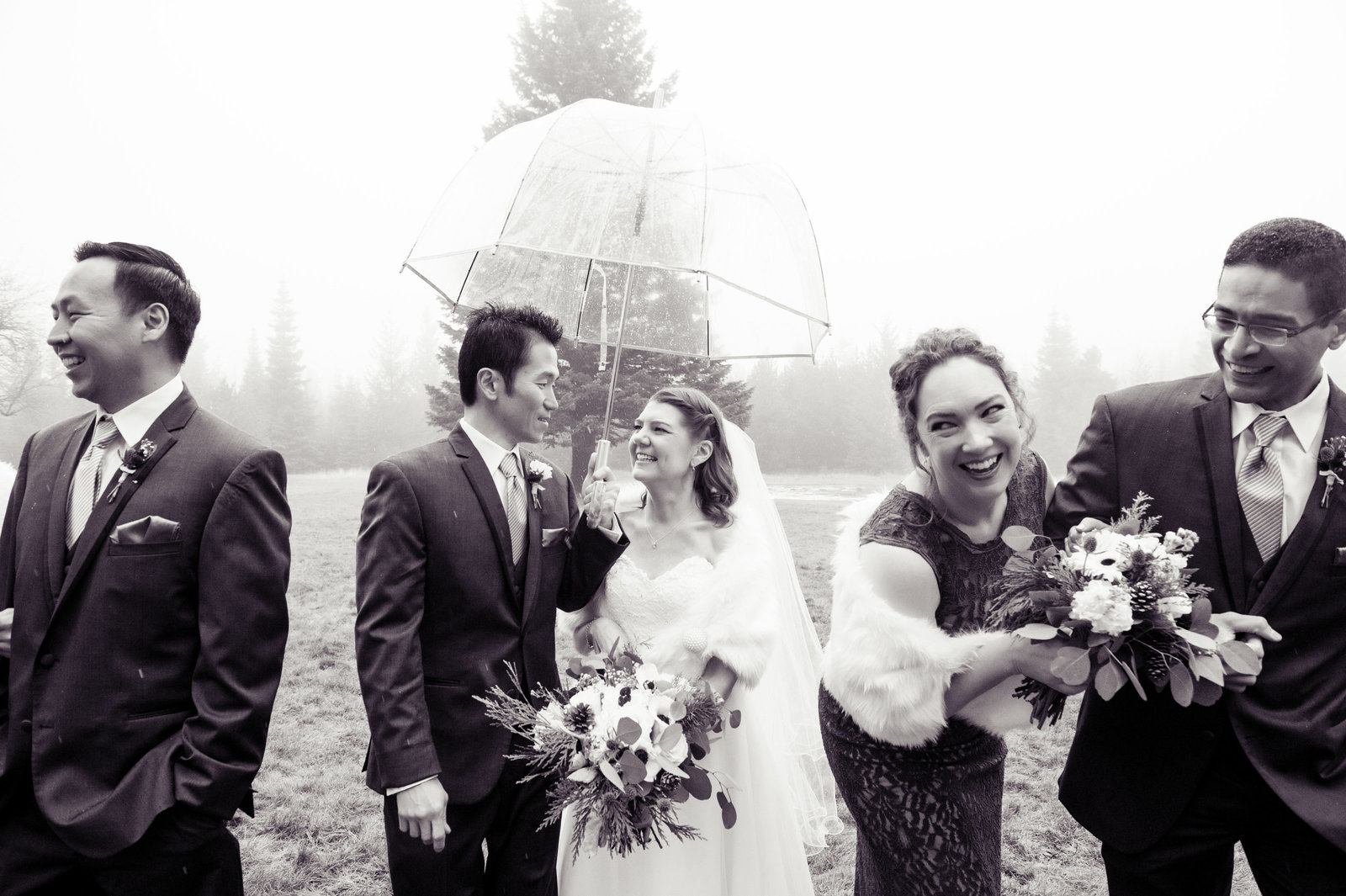 wedding party walk in the rain at cooper spur